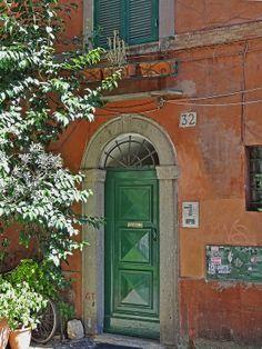 Front door, Vicolo del Leopardo, 32, Trastevere area of Rome, Italy | Terence Faircloth (atelier_tee), on Flickr.  #travel #europe #italy #rome #door #portal #window