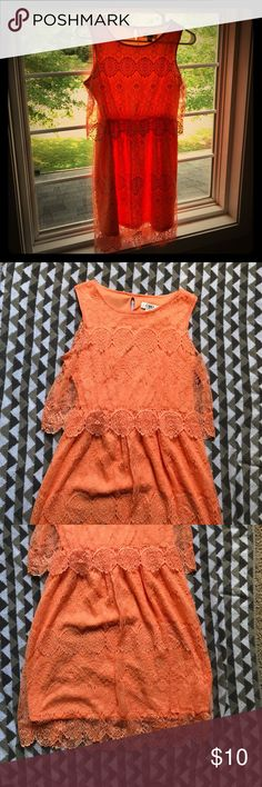 Beautiful Coral Lace Tiered Dress Keyhole Back  Beautiful Lace Dress. Coral color that is perfect for he summer. Tiered Lace design. Sleeveless with keyhole closure at back of neck. Size L - 14/16 Cato Dresses