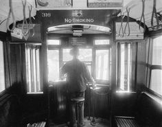 A motorman operates a trolley cars near Williamsburg Bridge, on September Signs advertise almonds, cold remedies, mustard, and stove polish. Historic Photos From the NYC Municipal Archives — In Focus — The Atlantic Old Photos, Vintage Photos, Williamsburg Bridge, S Bahn, Vintage New York, Vintage Black, Advertising Signs, Back In The Day, Historical Photos