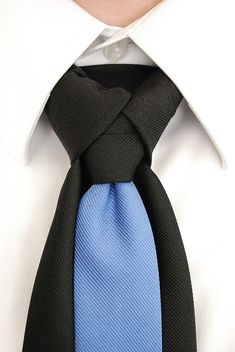 """How to tie the Merovingian knot, also known as the Ediety Knot; its' a way of tying a necktie which produces a neat, asymmetrical knot. This knot gives the appearance of three distinct pieces coming together to make the knot. Rather than just a single knot at the base of the neck, there is a left, right and center piece. Cool Fact: """"The Merovingian"""" was sported it The Matrix trilogy."""