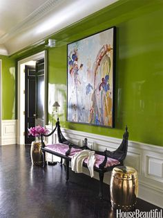 The windowless entry hall is brightened by lustrous walls that reflect light from adjoining rooms.  House Beautiful