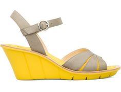 For Spring Summer 2013 Camper presents Filippa Low, an open sandal made of grey full grain leather uppers and a lightweight EVA wedge in yellow measuring 7 centimetres. . Packed with Camper character it offers a feminine, soft, Summer look.