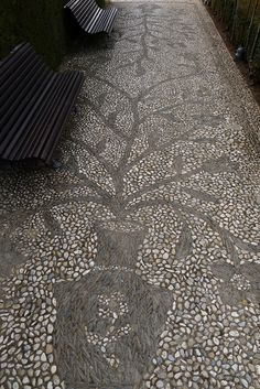 Pebble mosaic at The Generalife, Granada, Spain. Image by Jeff Bale. jeffreygardens.blogspot.com - See more at: http://www.inspirationgreen.com/index.php?q=pebble-pathways.html#sthash.IMJN7wZw.dpuf