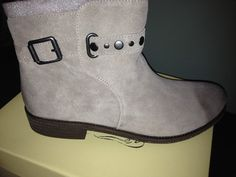 Lucky Brand Light Grey LK-Paulinne Ankle Boots Size 10M on sale for $99.00. This stylish ankle boot features a silver metal buckle with matching silver studs on the ankle.  A comfortable low heel gives this look wear-all-day capability. Upper boot and ankle are light grey suede.  The toe and back of ankle are oiled, giving the suede a darker tone