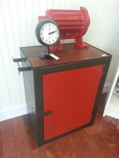 Metal Industrial Cabinet with a Red Door and Retro Clock
