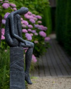 'Wednesday's Child' is a graceful statue by Helen Sinclair. Garden designed by Andy Sturgeon, Denbighshire