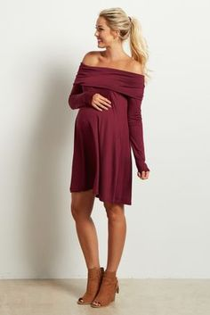 This pretty little number steps up your basics from average to oh-so-stylish. A shoulder baring neckline and stretchy material allows ultimate comfort for a simply chic look. Style this maternity dress with your favorite booties for a complete ensemble. Long Sleeve Maternity Dress, Maternity Dresses For Baby Shower, Spring Maternity, Maternity Tunic, Stylish Maternity, Off Shoulder Maternity Dress, Burgundy Dress, Fall Maternity Dresses, Feminine Fashion