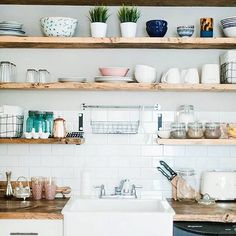 Happy Wednesday! Wishing I was spending the day outside with this gorgeous weather we are having ☀️ Ryan has already insisted on an afternoon walk when I get home from work. ⠀ ⠀ In the meantime, I will continue to stare at pretty and bright kitchens, like this one, to pass the time until the end of the day.⠀ _______⠀ Photo by @kassiedonaldson, design by @itstherealnia #SOdomino #littlewhiteloveshack ( # @dominomag via @latermedia ) #wednesday #darlingmovement #modern #simple #kitchendesign