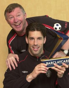 Manchester United boss Alex Ferguson poses with Ruud Van Nistelrooy after the striker is named Barclaycard Player of the Month