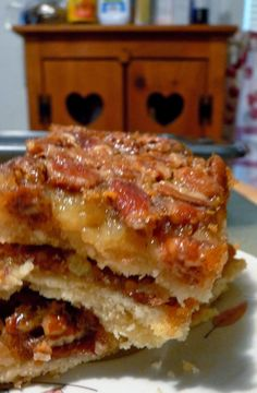 """Pecan Pie Bars - Favorite go- to dessert for parties and potlucks because it's baked in a 13x9 pan instead of a 9"""" pie pan. It's also the first dessert to disappear! Sooo goood!.."""