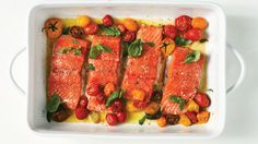 Slow Baked Salmon and Cherry Tomatoes - Cooking the salmon at a low heat makes for tender meat and a vibrant hue. Set off the fish's decadence with a little basil and a burst of tangy-sweet tomatoes. Salmon Recipes, Fish Recipes, Seafood Recipes, Dinner Recipes, Cooking Recipes, Healthy Recipes, Salmon Meals, Cooking Games, Cooking Classes