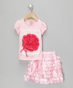 Mixing a comfy lace-adorned tee with a frilly, fluttery skirt, this darling set was designed for frolicking with the flowers. The tee's cotton construction and the skirt's elastic waistband keep this adorable ensemble comfy and snug.Includes tee and skirtTee: 95% cotton / 5% spandexS...