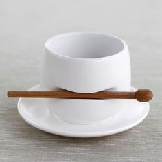 Tea/Coffee cup with built in stirrer & holder. Nifty!