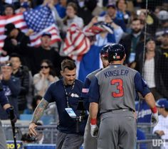 United States second baseman Ian Kinsler is welcomed home after hitting a two run homer in the World Baseball Classic final at Dodger…
