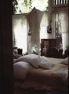 bedroom inspiration - bohemian, natural colors, neutral bedding and curtians, wood accents, green plants, gold. lots of textures.