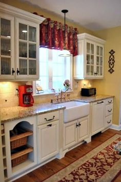 furniture style cabinets; farmhouse sink, small pendant, valance, light cabinetry, wood flooring