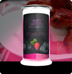 """Strawberry Candle - Boasting the juicy sweet scent of handpicked strawberries, with a touch of vanilla cream... this candle is truly """"fruit-tastic!!""""  Full size 21oz jewelry candle - 100% all natural Soy candle burns for 100 to 150 hours. YOU choose the Jewel in EVERY candle."""