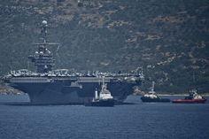 The aircraft carrier USS Harry S. Truman (CVN 75) departs Souda Bay, Greece, after a port call.