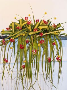 Pandanus leaves were folded and woven into each other. I used Gloriosa hanging in test tubes to finish the arrangement. Great for unusual podium arrangement or ceremony altar Ikebana Flower Arrangement, Church Flower Arrangements, Floral Arrangements, Art Floral, Floral Design, Flower Show, Flower Art, Gloriosa Lily, Corporate Flowers