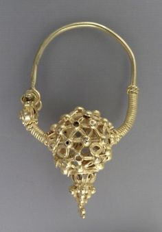 Earring, Iran, first half of 11th century. Jewelry and Adornments; earrings. Gold, fabricated entirely from sheet, wire and granules. Height: 1 3/8 in. (3.49 cm)