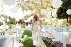 white balloons in an outdoor wedding contrast with the natural scenery