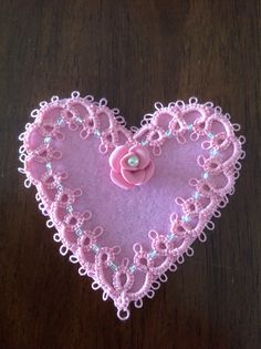 Tatting pattern found on Pinterest, and I glued it and a polymer rose onto a felt heart.