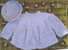 Baby's traditional lilac / mauve Diamond lace matinee jacket and hat set.