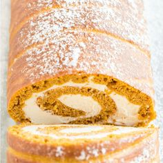 Impress your guests with delicious pumpkin roll! An easy pumpkin sheet pan cake combines with a silky cream cheese filling for an irresistible dessert that will look like you spent hours making it. Pumpkin Roll Cake, Pumpkin Pie Mix, Canned Pumpkin, Cheesecake Recipes, Dessert Recipes, Desserts, Moist Yellow Cakes, Savory Pumpkin Recipes, Spice Cake Mix