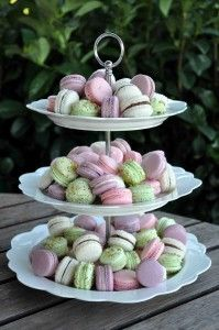 3 towers: two macaron towers, one tower small macarons on bottom cake on top.