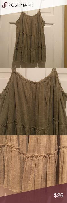 Free people Khaki greenish tan free people sleeveless top with frayed hems and adjustable straps. Free People Tops Blouses