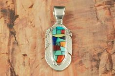 Genuine Turquoise, Spiny Oyster Shell and Blue Lapis inlaid in Sterling Silver. Beautiful Mosaic Design. Designed by Navajo Artist Calvin Begay.