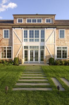 Barn Door. Exterior Barn Door. Exterior Barn Door Ideas. This beautiful barn styl is really trending in the Hamptons. #BarnDoors #ExteriorBarnDoor MKL Construction Corp.