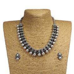 This designer charming Oxidized German silver necklace is neat and simple for those who wish for light jewelry. Match this jewelry with any of your outfit and flaunt your style. Silver Jewellery Indian, Silver Jewelry, Silver Ring, Silver Anklets, Temple Jewellery, Tribal Jewelry, Pendant Jewelry, Silver Choker Necklace, Necklace Set