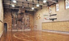 indoor-basketball-court-with-laminate-floor-feat-amazing-stone-climbing-wall-and-track-lighting-idea-591x353