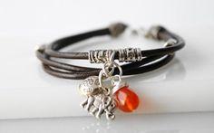 Orange and brown Bohemian Bracelet by @Esther Aduriz Aduriz Aduriz Prat #wrappedinleather #leathercord #bohemian #bracelet #elephant #charm