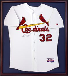 Cardinals jersey perserved in mahogany frame with a deep blue mat.  Designed and framed at Art & Frame Express in Edison, NJ.