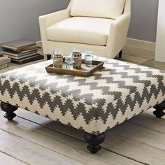 Make an ottoman from a pallet, foam, table legs, fabric and a staple gun.