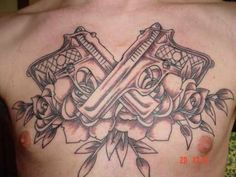 Chest Tattoo # 73 - Rose tattoo with guns, one of the most favorable masculine chest tattoo ideas for guys:)