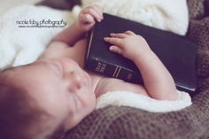 Sweet newborn with bible. newborn pose. Raleigh North Carolina Newborn Photographer. Nicole Faby photography