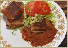 Pie Iron Chicken Chimichangas and lots more good pie iron recipes. Good site.