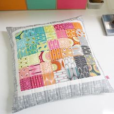 pillow made from a minicharmpack of FOR YOU fabrics by Zen Chic for Moda
