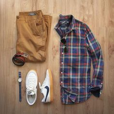 Blue red plaid button down shirt, tan pants, white sneakers