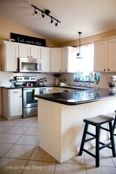 Learn how to update the look of your kitchen by painting your old cabinets with a fresh coat of white paint!