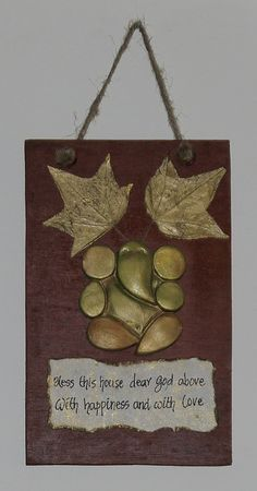 the fall ganesha: gold with leaves on polished wood