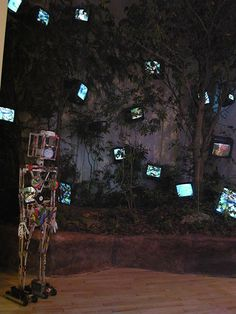 Paik was known for making robots out of television sets. These were constructed using pieces of wire and metal, but later Paik used parts from radio and television sets. Nam June Paik, Earth Hour, Fluxus, Television Set, Plant Lighting, Retro Futurism, Types Of Art, Medium Art, American Artists