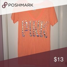 PINK T-Shirt This is a super comfy, light neon orange with silver writing t-shirt. PINK Victoria's Secret Tops Tees - Short Sleeve