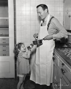 Jack Benny shows off his cooking skills to daughter Joan.