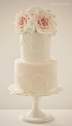 Lace, pearls, just add a little pale blue to it and its my perfect wedding cake!!!!!!