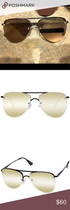 Le Specs sunglasses Gold with black frames NWOT NEW FRAMELESS AVIATORS   DESCRIPTION Frame:Matte Black Lens:Gold Revo Mirror Protection: Category 3 Lens -Good UV protection Packaging:Le Specs protective pouch included Gender:Women Model:LSP1602140  DESIGNER NOTES This futuristic update on the classic aviator features completely flat lenses, and spring hinges for maximum comfort. Le Specs Accessories Sunglasses