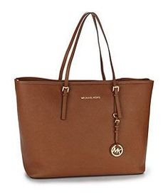 5fab630630b4 MICHAEL Michael Kors Medium Leather Travel Tote the price is right and the  look is classic